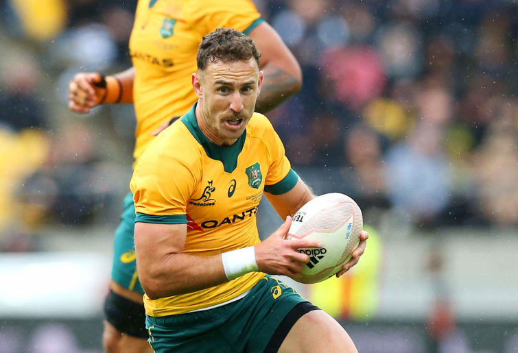 Wallabies' Nick White manages the ball
