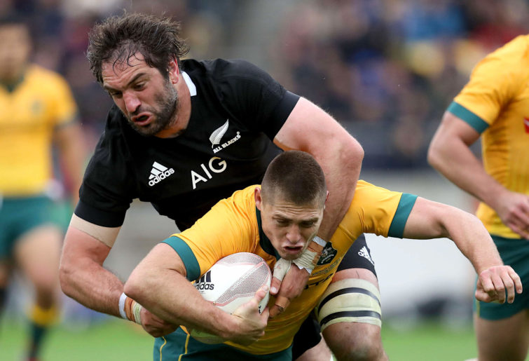 Samuel Whitelock of the All Blacks tackles James O'Connor of the Wallabies