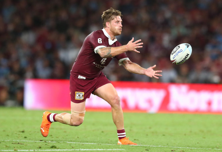 Cameron Munster of the Maroons passes