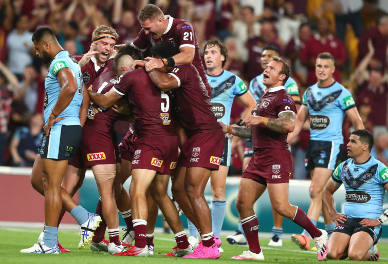 Maroons celebrate a try by Harry Grant during game three of the State of Origin series