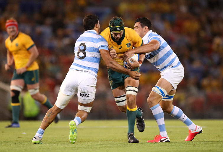 Rob Simmons of the Wallabies is tackled during Tri-Nations match