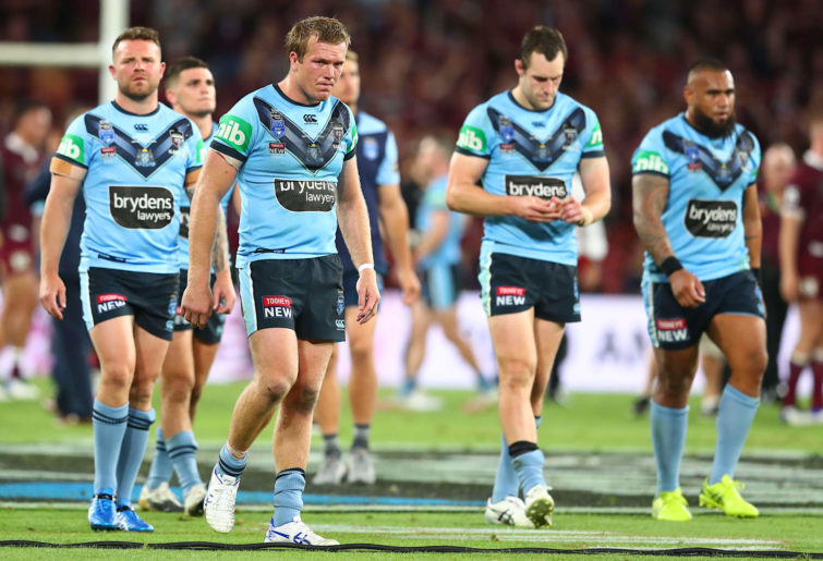 Blues players including Jake Trbojevic leave the field