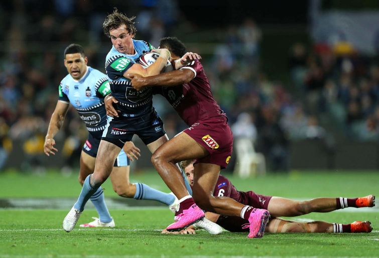 Clint Gutherson of the Blues is tackled