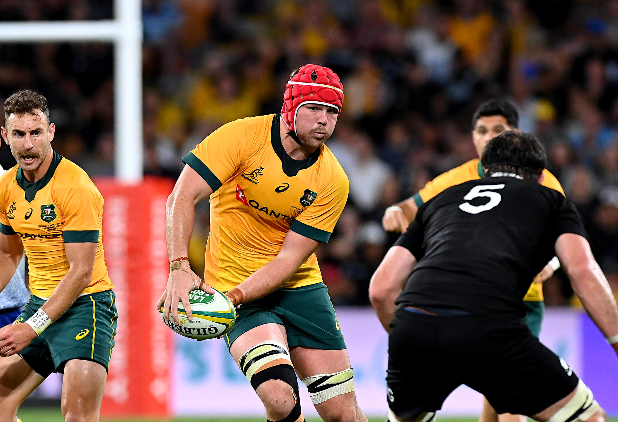 Harry Wilson of the Wallabies goes for a run