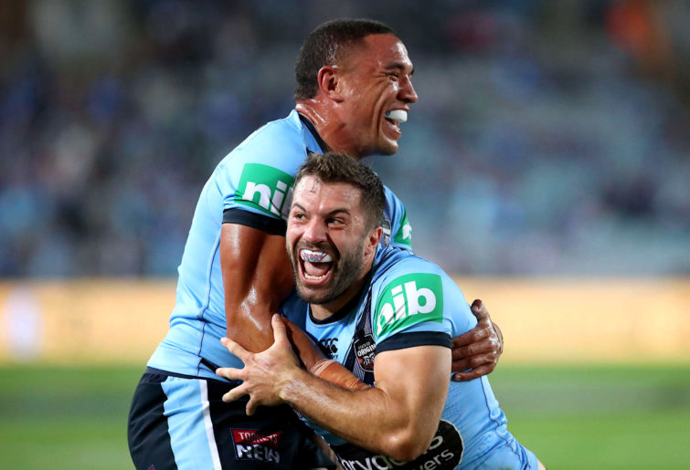 James Tedesco and Tyson Frizell celebrate for the Blues