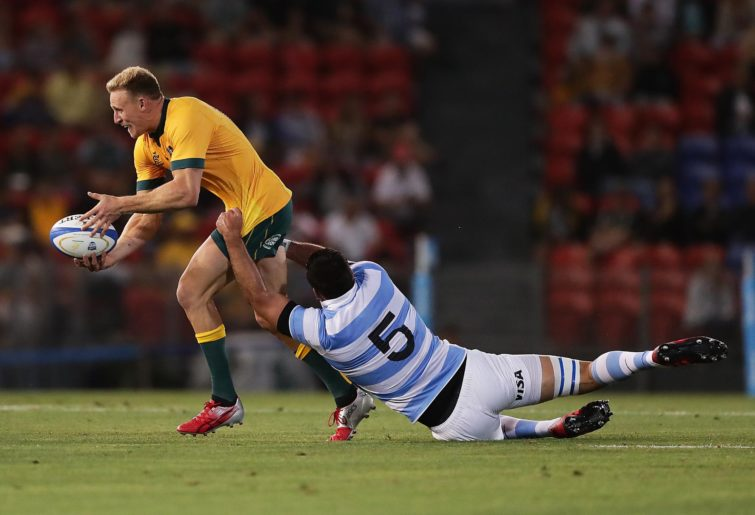 Reece Hodge is tackled by Matias Alemanno