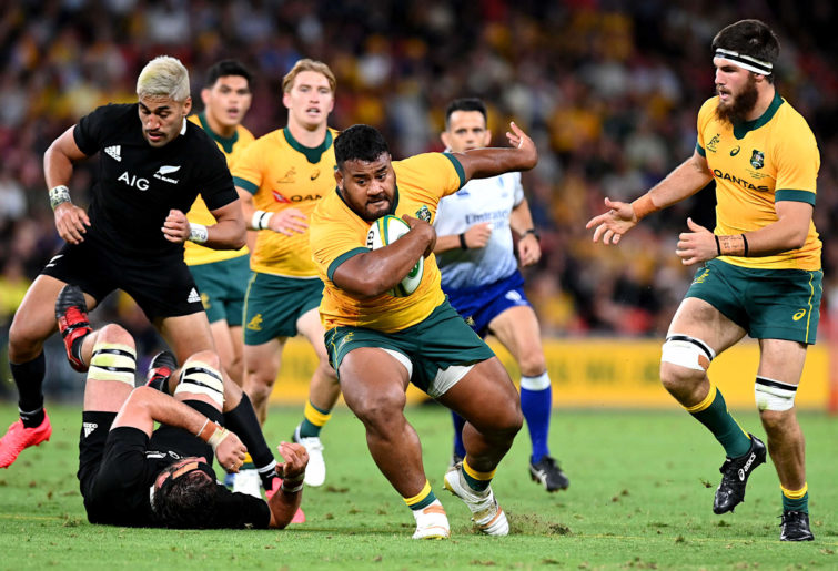 Taniela Tupou of the Wallabies breaks through the defence