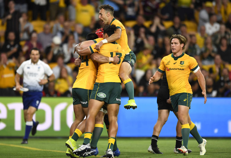 Wallabies players celebrate a Tom Wright try