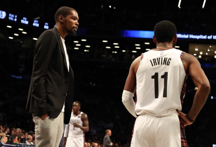 Kevin Durant of the Brooklyn Nets talks to Kyrie Irving