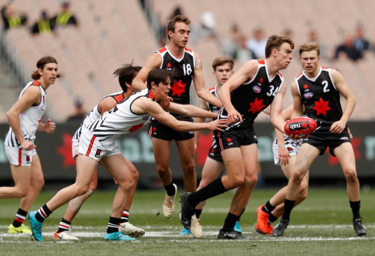 Riley Thilthorpe of team Brown handballs during the NAB League 2019 All Stars match between Team Dal Santo and Team Brown at the Melbourne Cricket Ground on September 28, 2019 in Melbourne, Australia. (Photo by Darrian Traynor/AFL Photos via Getty Images)