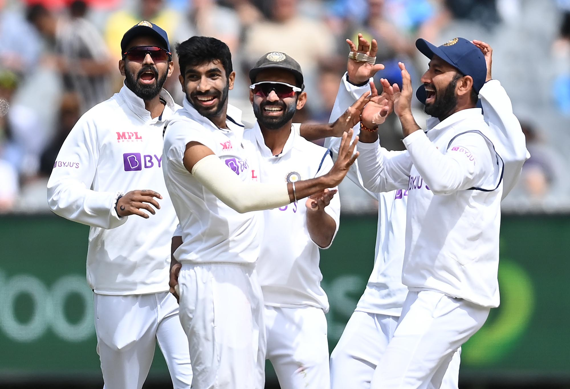 Jasprit Bumrah celebrates with his Indian team