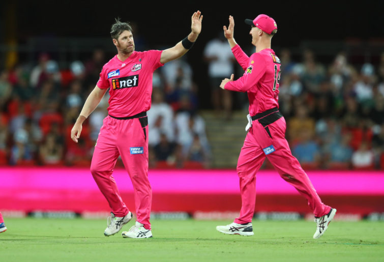 Dan Christian of the Sixers celebrates a wicket