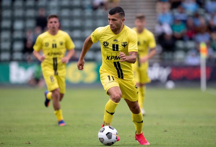 Jaushua Sotirio of Wellington Phoenix controls the ball
