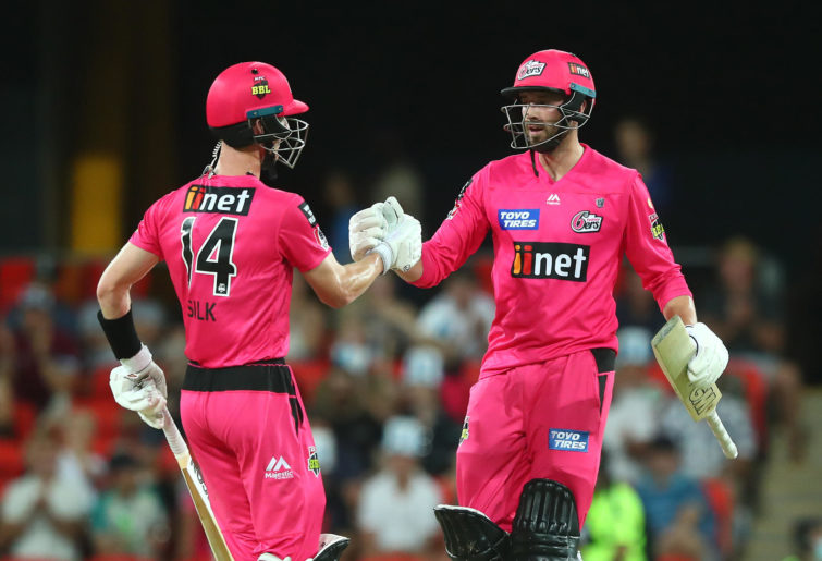 Jordan Silk and James Vince of the Sixers celebrate winning a Big Bash League