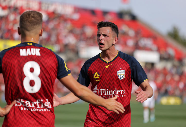 Louis D'Arrigo of Adelaide United reacts during the round one A-League match