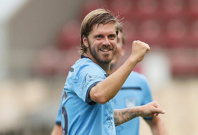 Luke Brattan of Sydney FC celebrates scoring a goal