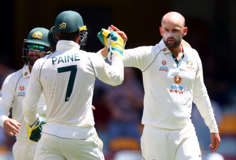 Australia's Nathan Lyon (R) celebrates his wicket of India's batsman Shubman Gill