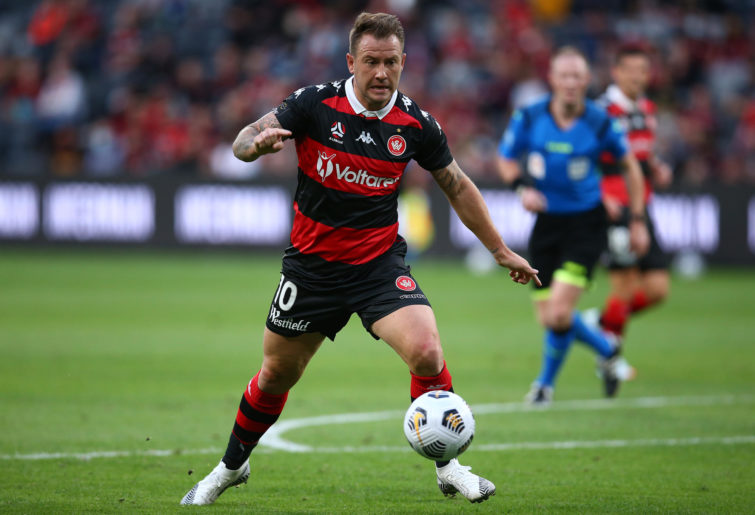 Simon Cox of the Wanderers controls the ball