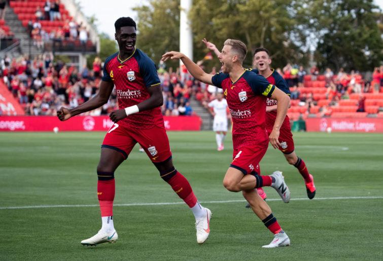 Stefan Mauk of Adelaide United scores a goal