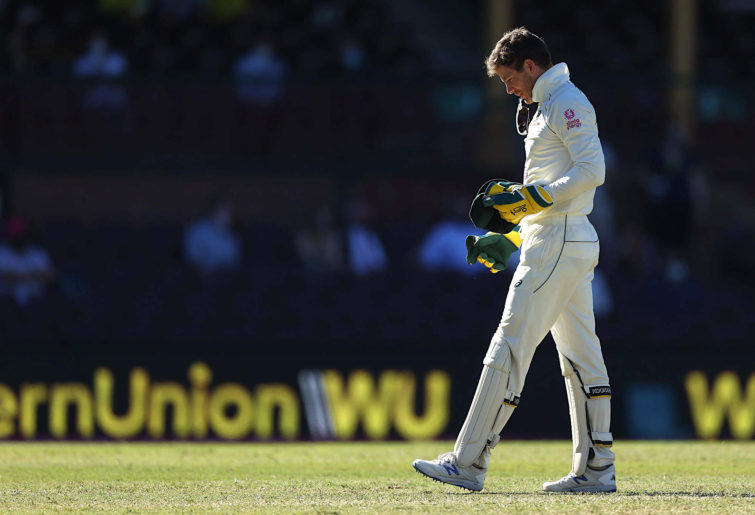 Tim Paine of Australia reacts after dropping a catch