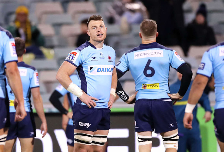 Jack Dempsey of the Waratahs looks dejected