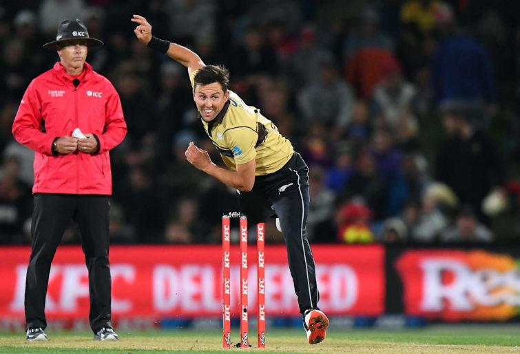 Trent Boult of New Zealand bowls