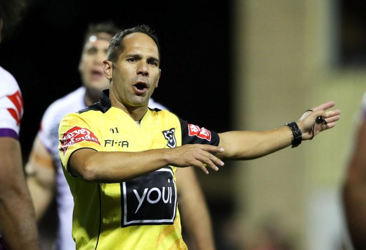 Referee Ashley Klein awards a penalty