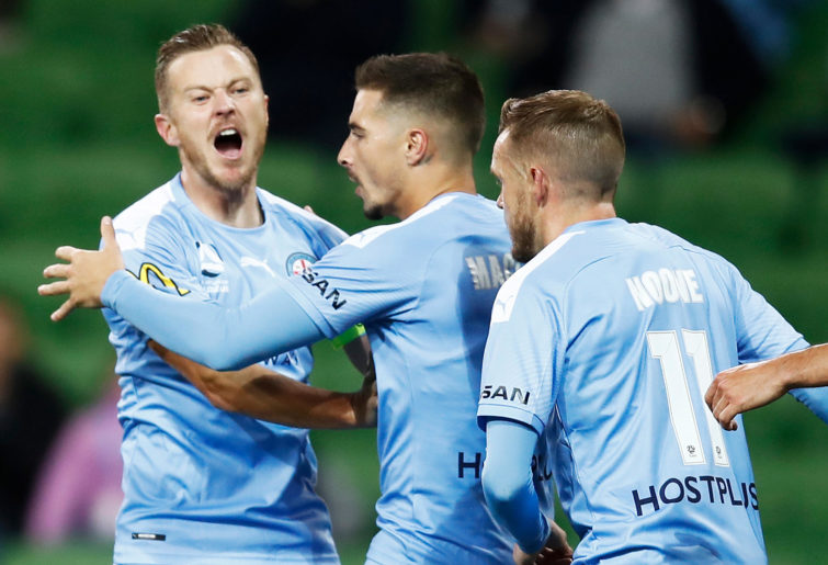 Jamie Maclaren of Melbourne City (C) celebrates with Scott Jamieson (L) and Craig Noone of Melbourne City
