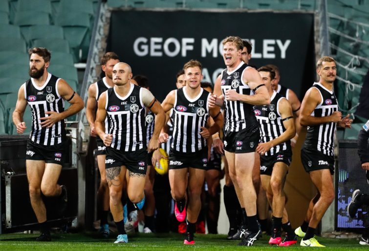 Port Adelaide run onto the field