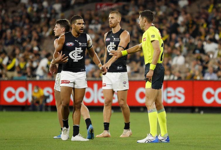 Sam Petrevski-Seton of the Blues argues with AFL Field Umpire Craig Fleer