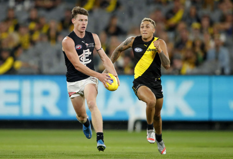 Sam Walsh of the Blues in action ahead of Shai Bolton
