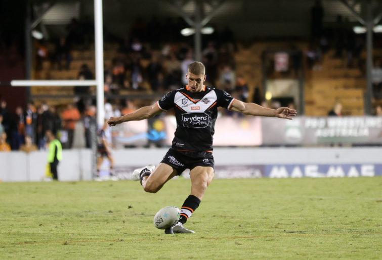 Adam Doueihi of the Tigers converts the try