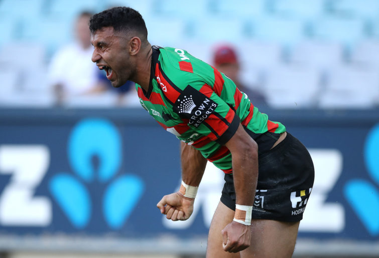 Alex Johnston of the Rabbitohs celebrates after scoring a try