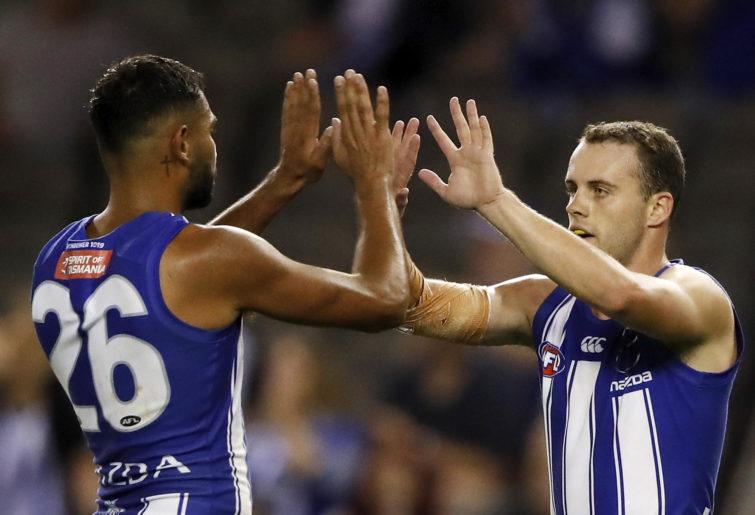 Jack Mahony of the Kangaroos celebrates a goal