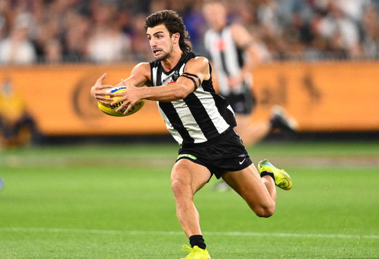 Josh Daicos of the Magpies gathers the ball
