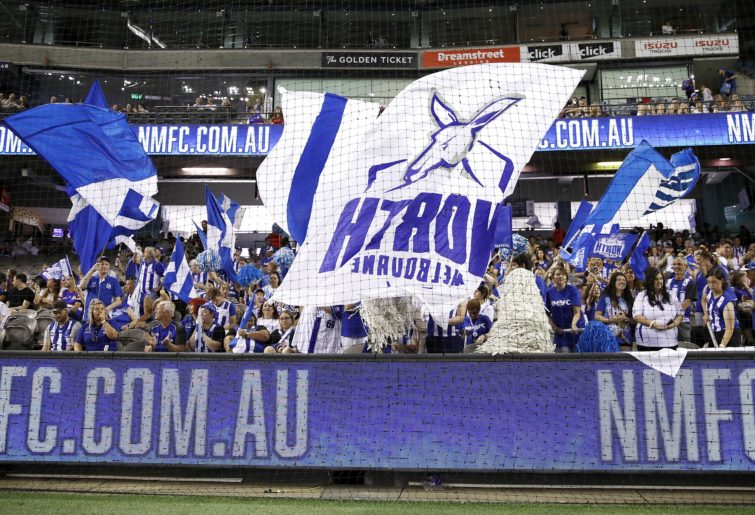 The North Melbourne cheer squad show their support