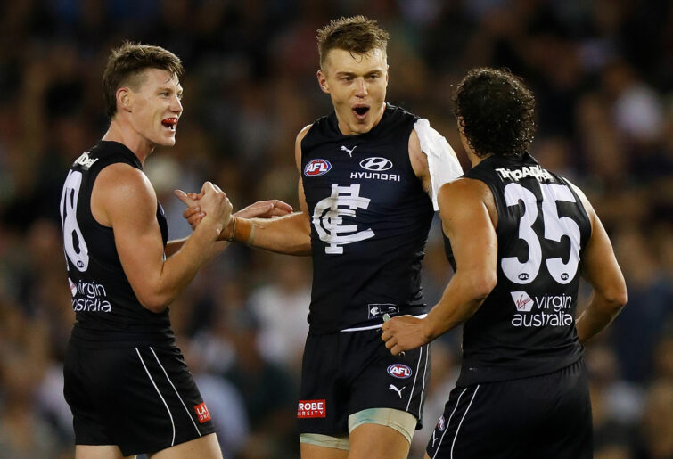 (L-R) Sam Walsh, Patrick Cripps and Ed Curnow of the Blues celebrate