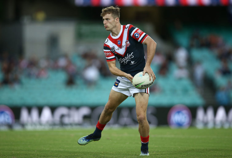 Sam Walker of the Roosters warms up