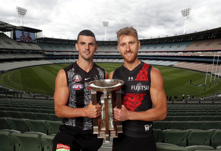 Scott Pendlebury of the Magpies and Dyson Heppell of the Bombers