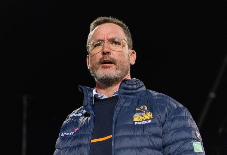 Head Coach Dan McKellar of the Brumbies looks on