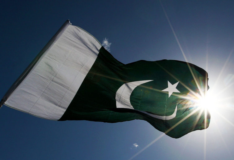 Pakistan supporters wave their national flag