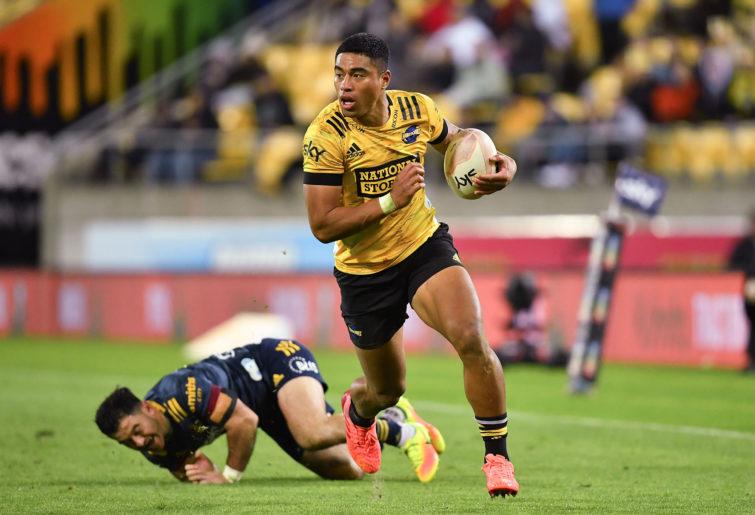 Hurricanes' Salesi Rayasi beats a tackle to score