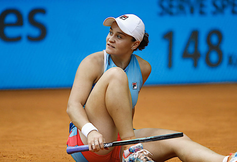 Ash Barty looks on.