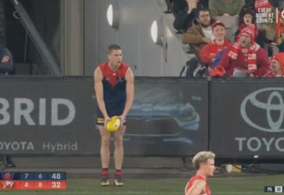Tom McDonald defies a Swans heckler in his ear to kick a brilliant goal from the boundary