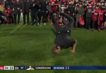 Crusaders coach breaks it down in the wet after winning final