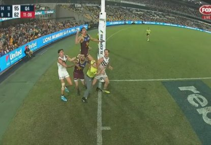 Goal umpire used as a step-ladder by a flying Joe Daniher