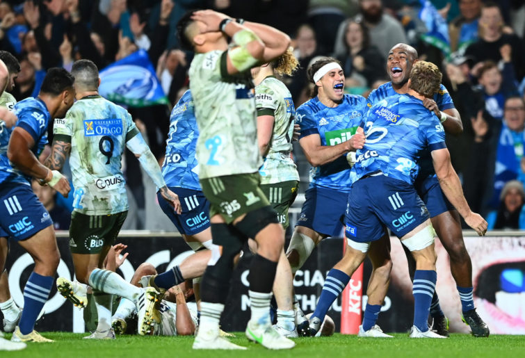 Blake Gibson of the Blues celebrates after scoring the match-sealing try.