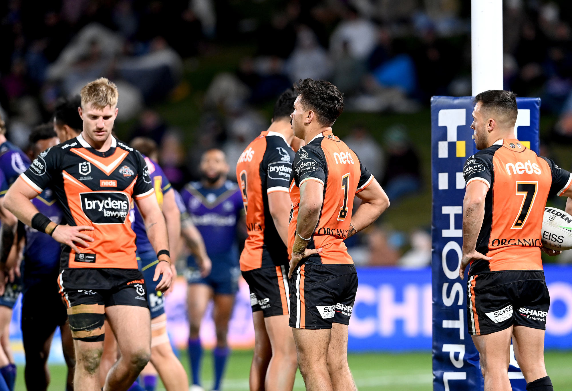uke Garner, Daine Laurie and Luke Brooks look dejected after a try by Jahrome Hughes.