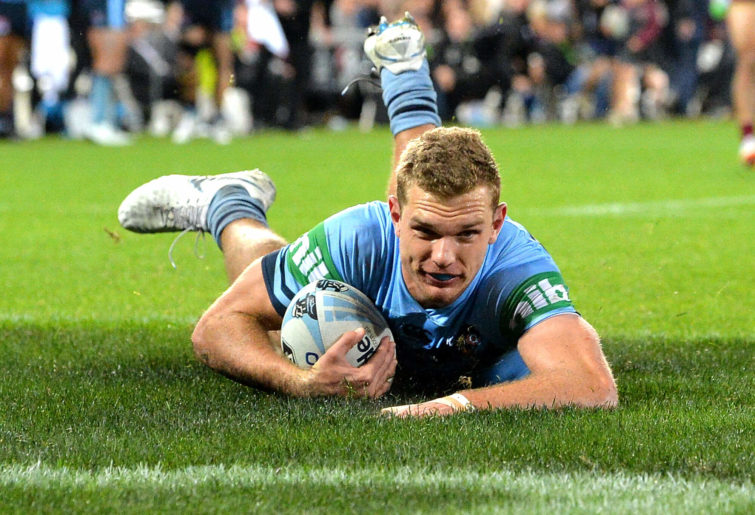 Tom Trbojevic of the Blues scores a try