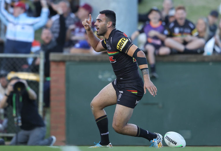 Tyrone May of the Panthers celebrates after scoring a try.